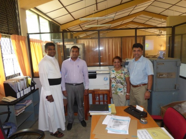 Sri Lanka Medical Mission - new copy machine installed in the clinic office - Giribawa