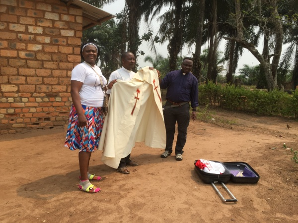 Ide and Father delivering vestments