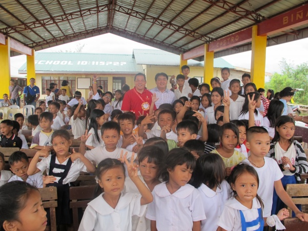 Executive Director Deacon Rick Medina visits with the Agtatacay Notre Elementary students - Philippines