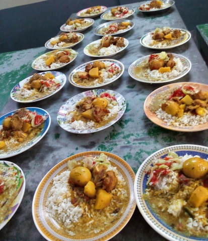 Bangladesh - Special Christmas meal including eggs and meat for the Bottomley Home residents. They normally only eat rice and lentils for their daily meal.