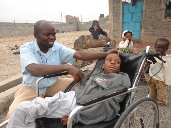 Brother Edson caring for Gabriel - Kenya