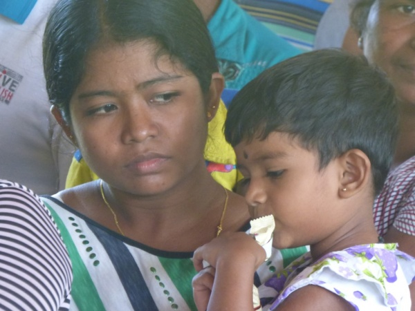 Sri Lanka Medical Mission - a young mother and her daughter wait to be seen - Giribawa