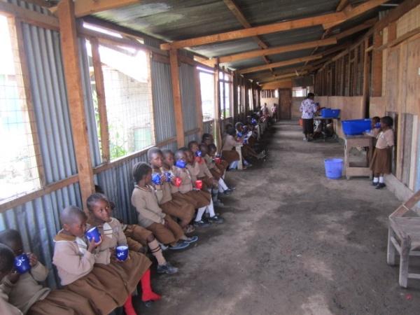 Good Shepherd Academy students having lunch - Kenya