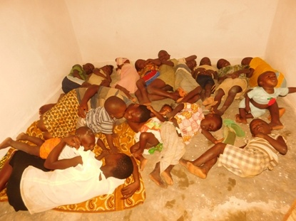 Children crammed in tiny one-room apartment in Kananga