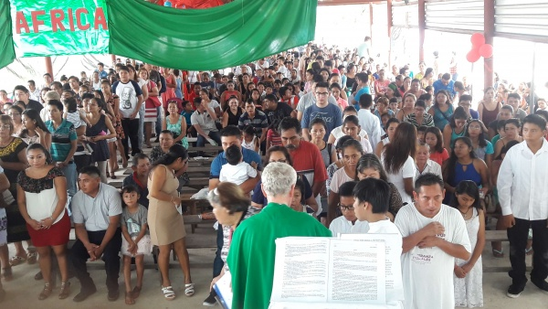 Fr. Bernard celebrates Mass in an outdoor pavilion until the church is finished.