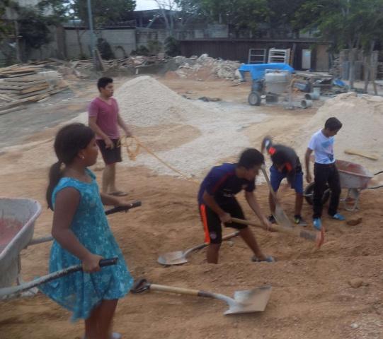 Playa del Carmen, Mexico - construction on Corpus Christi parish--even children help!