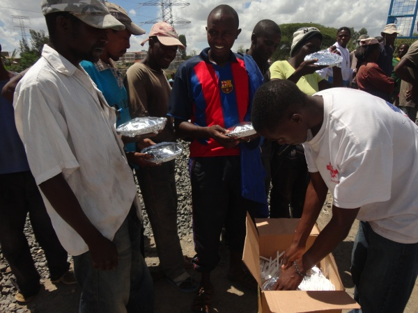 Members of the community still have to work on Easter Day; the brother bring food to celebrate - Kenya