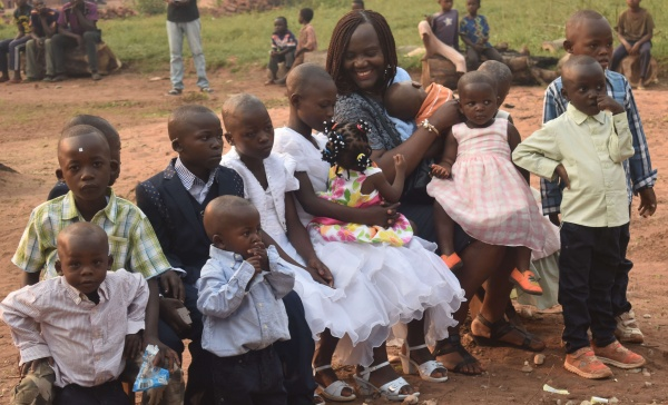 Ide shares a smile with the children