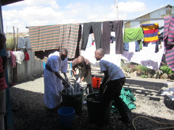 Brother doing the children\'s laundry - Kenya