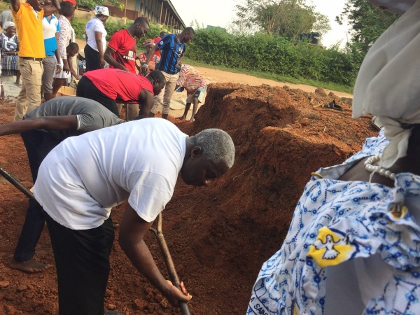 Ghana - construction update, January 2017; Monsignor Simon helps dig