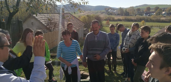 2017 Fall Mission trip - praying over families in Hungary