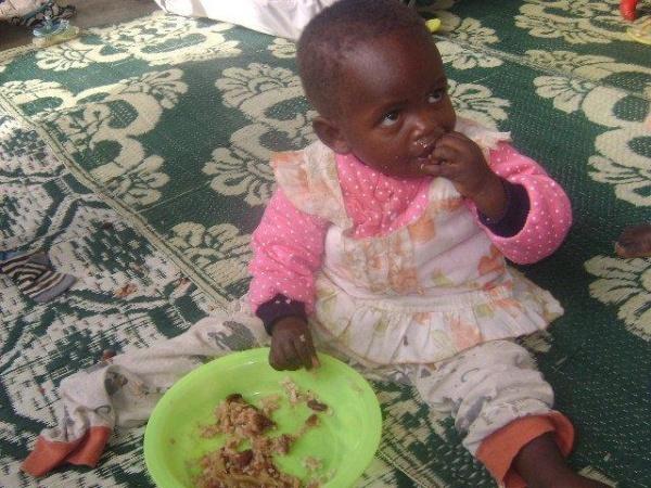 A child eats a humble meal - Kenya
