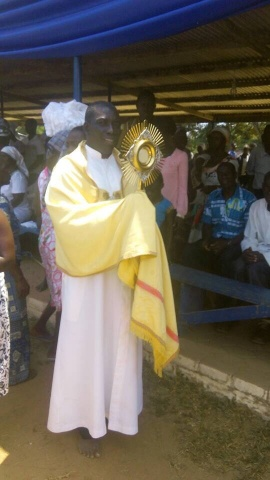 Fr. Anthony Eshun processes with the Blessed Sacrament at the Our Lady of Lourdes grotto in Ghana.