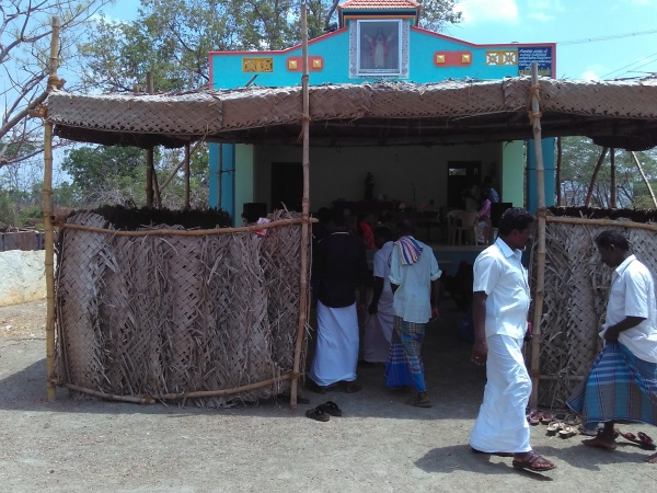 Another view of Easter Sunday\'s celebration under thatched shelter
