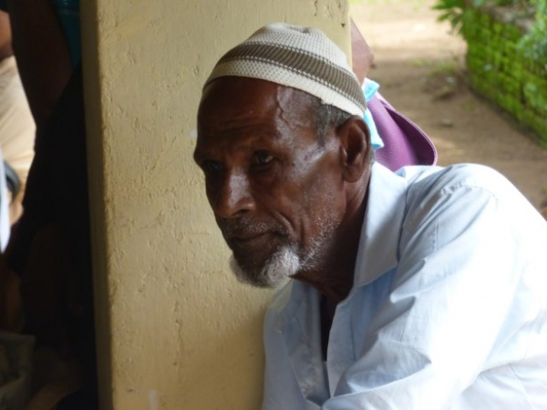 Sri Lanka Medical Mission - a Muslim patient waits to be seen by doctors - Giribawa