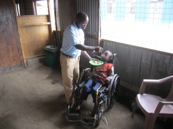 The brothers feed the disabled children - Kenya