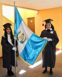 With the Guatemalan flag