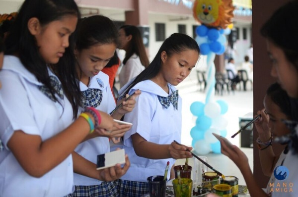MA Philippines - 7th Grade students painting in preparation for the Idea Carnival