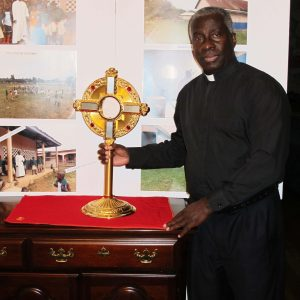 Monsignor Simon, of Ghana, receives a monstrance while visiting Atlanta