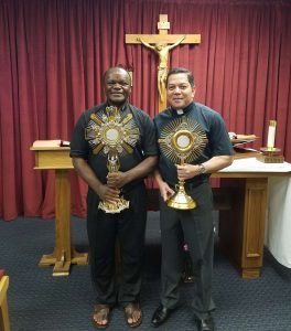 Deacon Rick, R, presents Fr. Eugen with a new monstrance for the Diocese of Kumbo, Cameroon