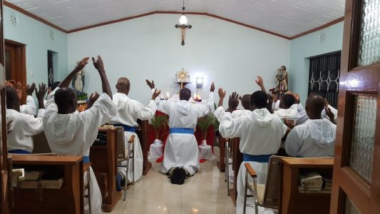 Missionaries of the Poor praying and praising before the Blessed Sacrament in Kenya