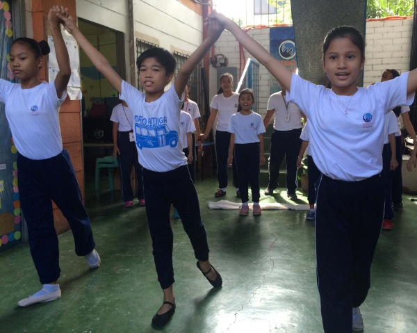 MA Philippines students perform a dance in their classroom