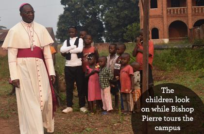 Bishop Pierre with children at Ndekesha Orphanage, DR Congo