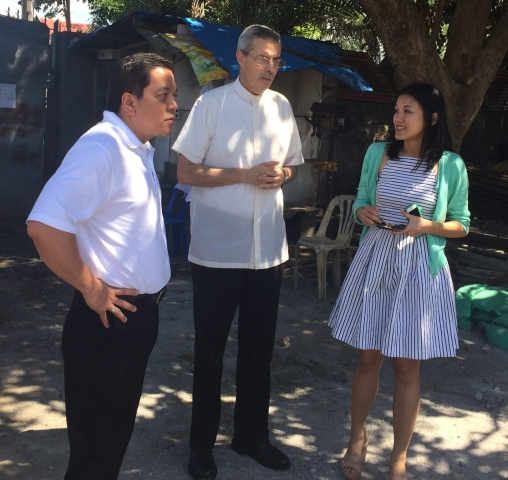 Deacon Rick and Lyn speak with a priest outside the MA Philippines campus