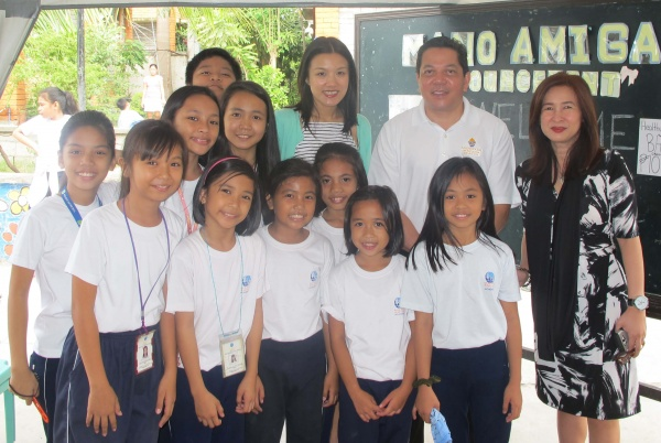 Deacon Rick and Lyn pictured with a Mano Amiga Philippines class