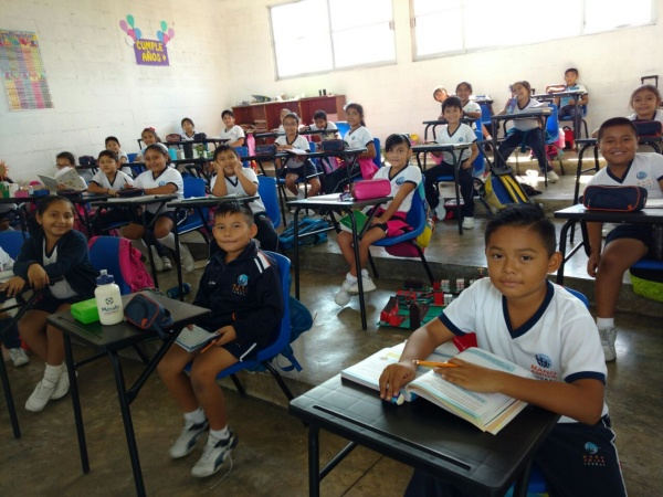 Mexico - MA Conkal\'s students showing off their new desks!