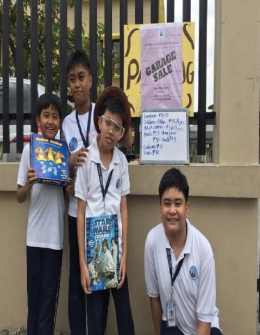 MA Philippines 8th graders advertising their Autism Awareness fundraiser - a garage sale!