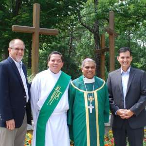 Board members Oscar Tanaka and Nick Donnelly, pictured here with Deacon Rick Medina and Bishop Perera