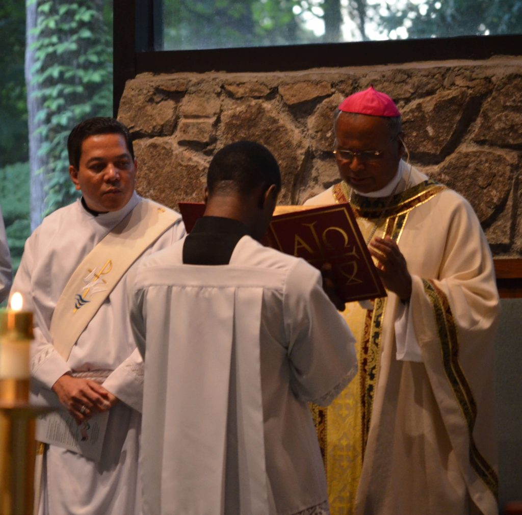 Archbishop George Antonysamy celebrates mass with Deacon Rick Medina as principal deacon in Atlanta, GA, August 2017