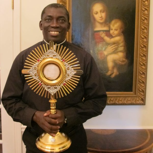 Fr. Anthony, now in Ghana, receives his monstrance while on assignment in Atlanta
