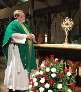 Fr. Joel Grissom prepares to present the new monstrance