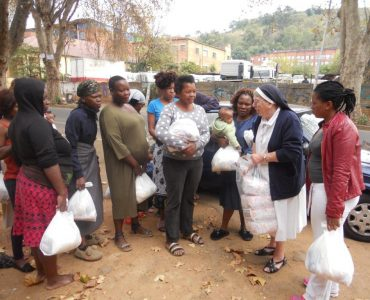 Sister Bridget distributes goods to women and mothers in need in Johannesburg as part of Nazareth House's Community Outreach Program