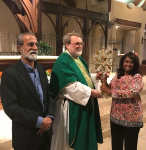 The Joseph family receives the monstrance on behalf of Cardinal Coutts of Pakistan