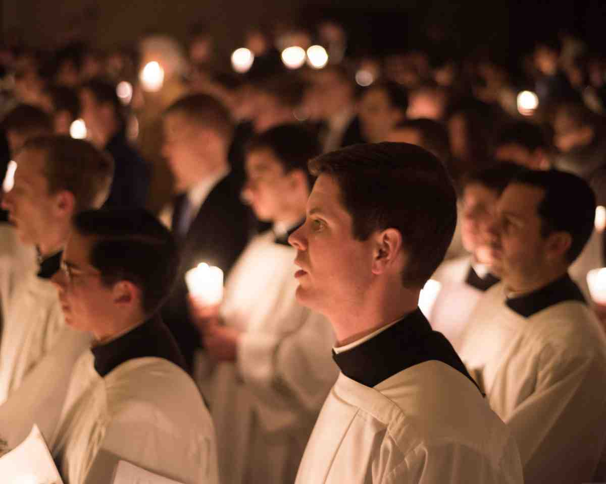 Seminarians in Rome pray during a candlelight vigil