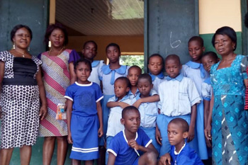 Teachers and students at Holy Rosary Primary School in Nigeria