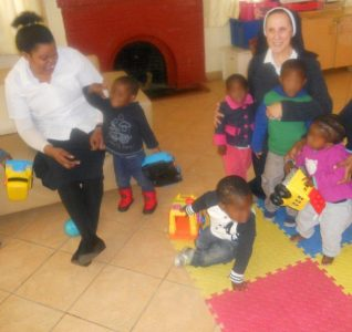 A Sister of Nazareth with children at Nazareth House Johannesburg