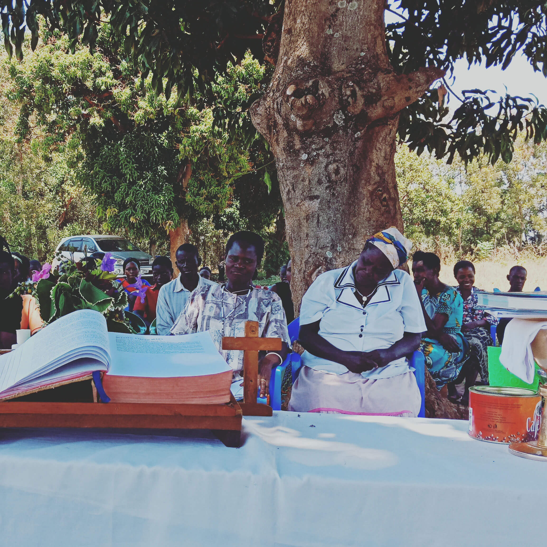 Our brothers and sisters in Kiyamwinula, Uganda celebrate Mass under the mango tree.