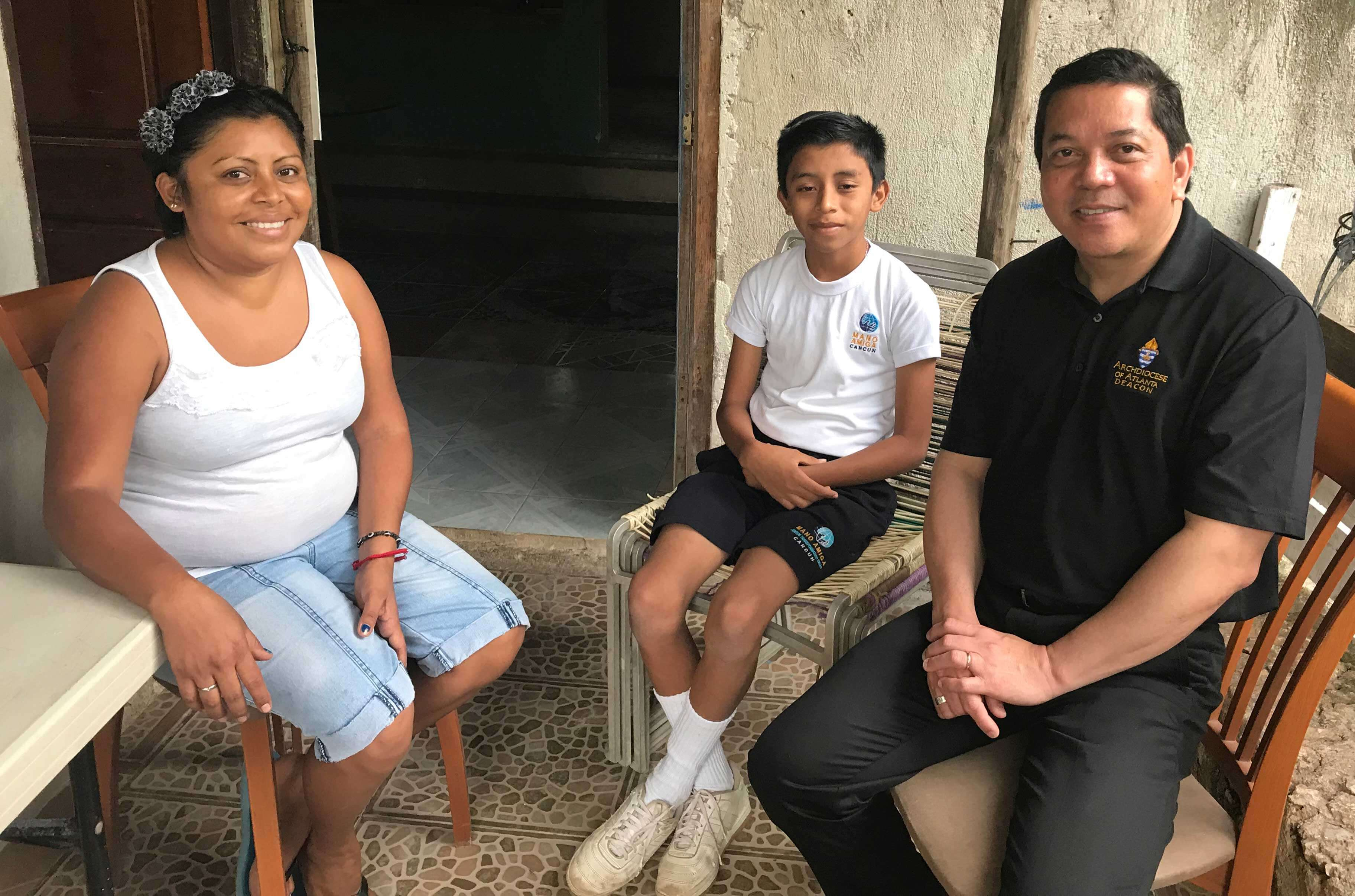 Deacon Rick visits a Mano Amiga student and his mother at their family home.