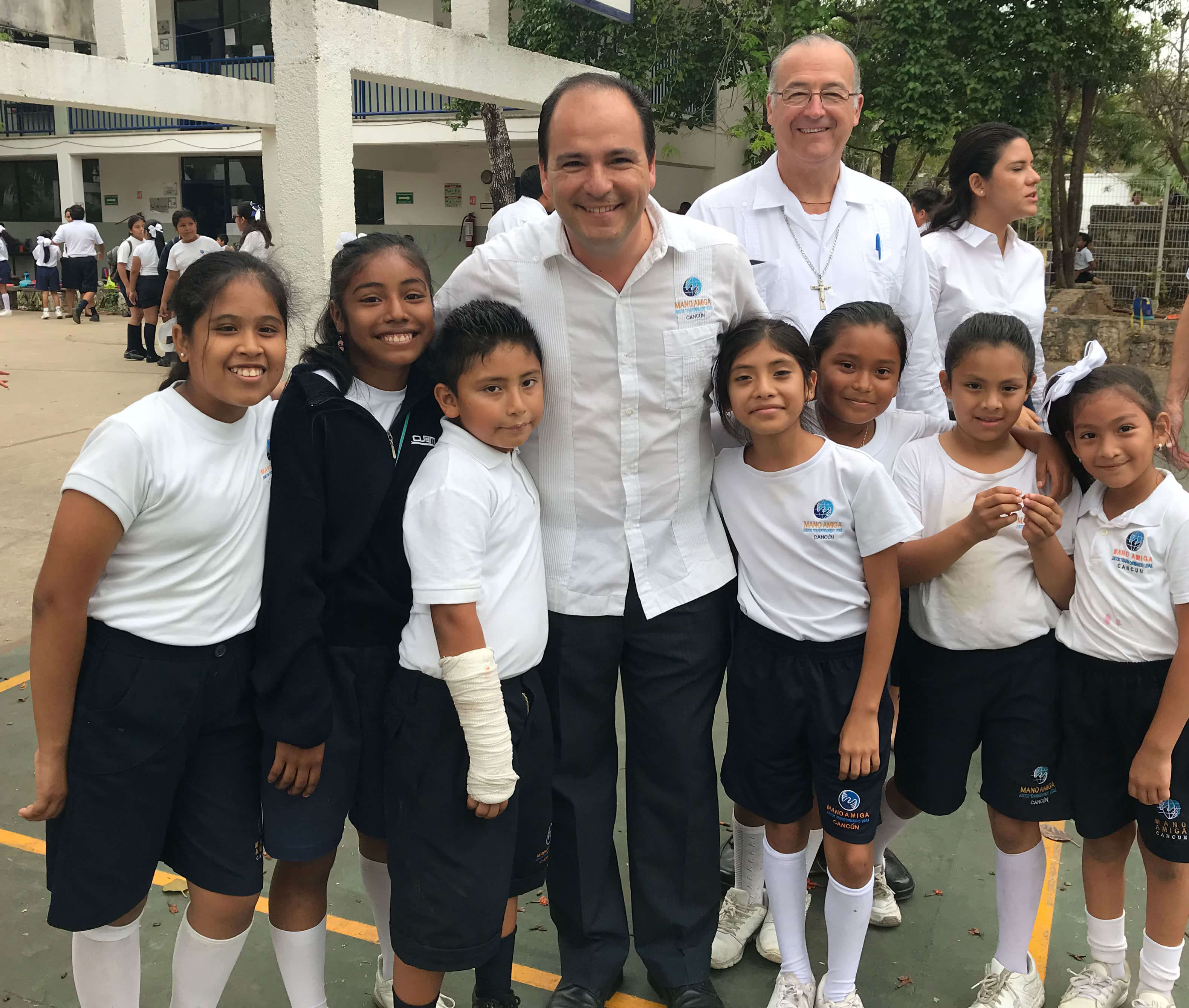 Students with the chaplain and principal