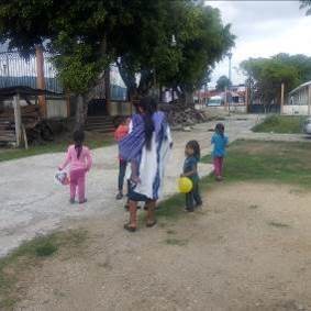 A mom with her children leaving San Juan Cancuc clinic after being seen and treated