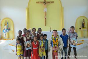 Deacon Rick Medina with missionary kids