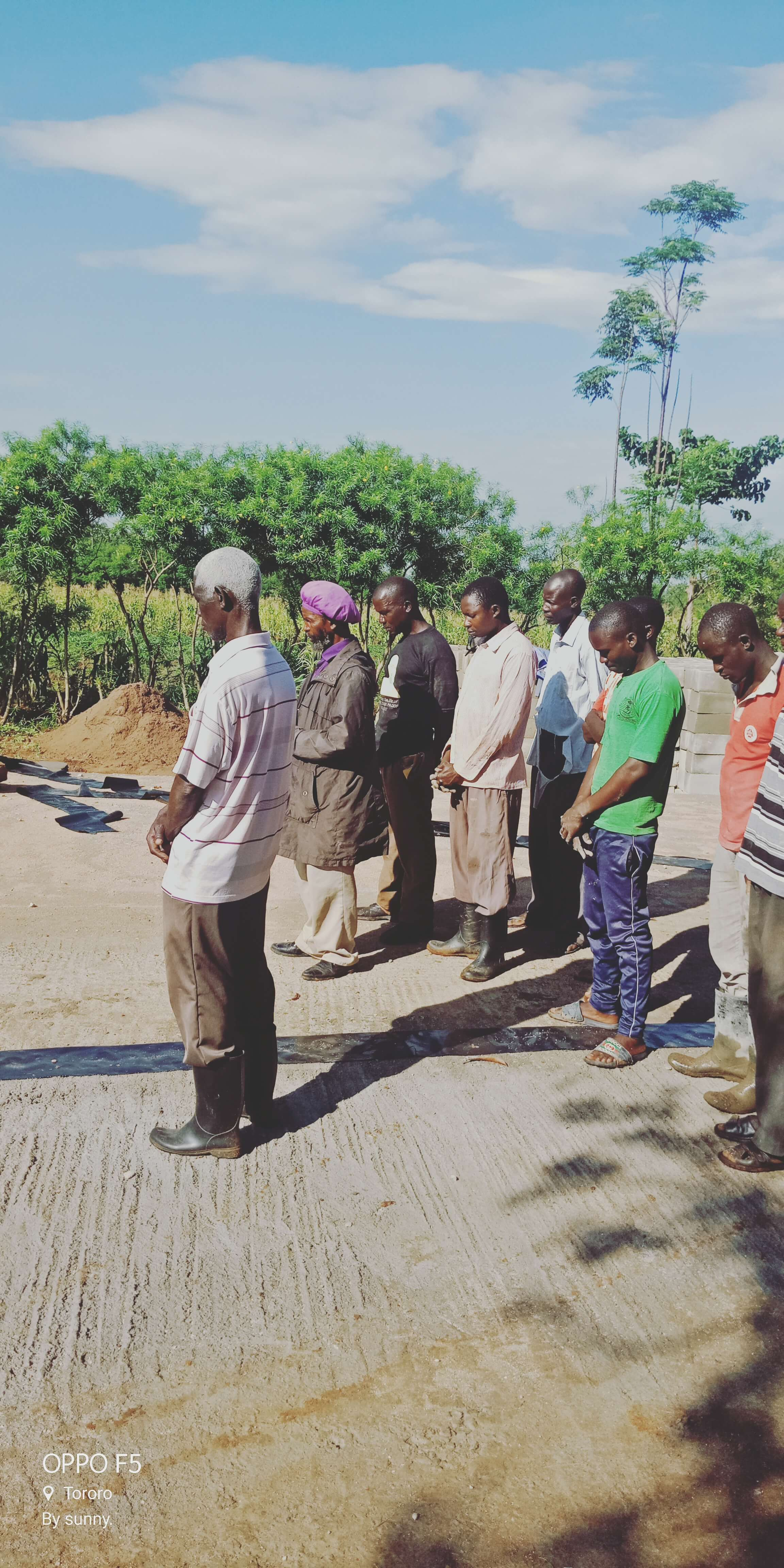 Villagers gather to pray before starting work for the day
