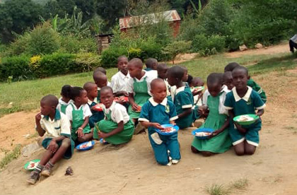 Children at St. Philomena need your help. Today, they eat their meals on their ground, as you can see here.