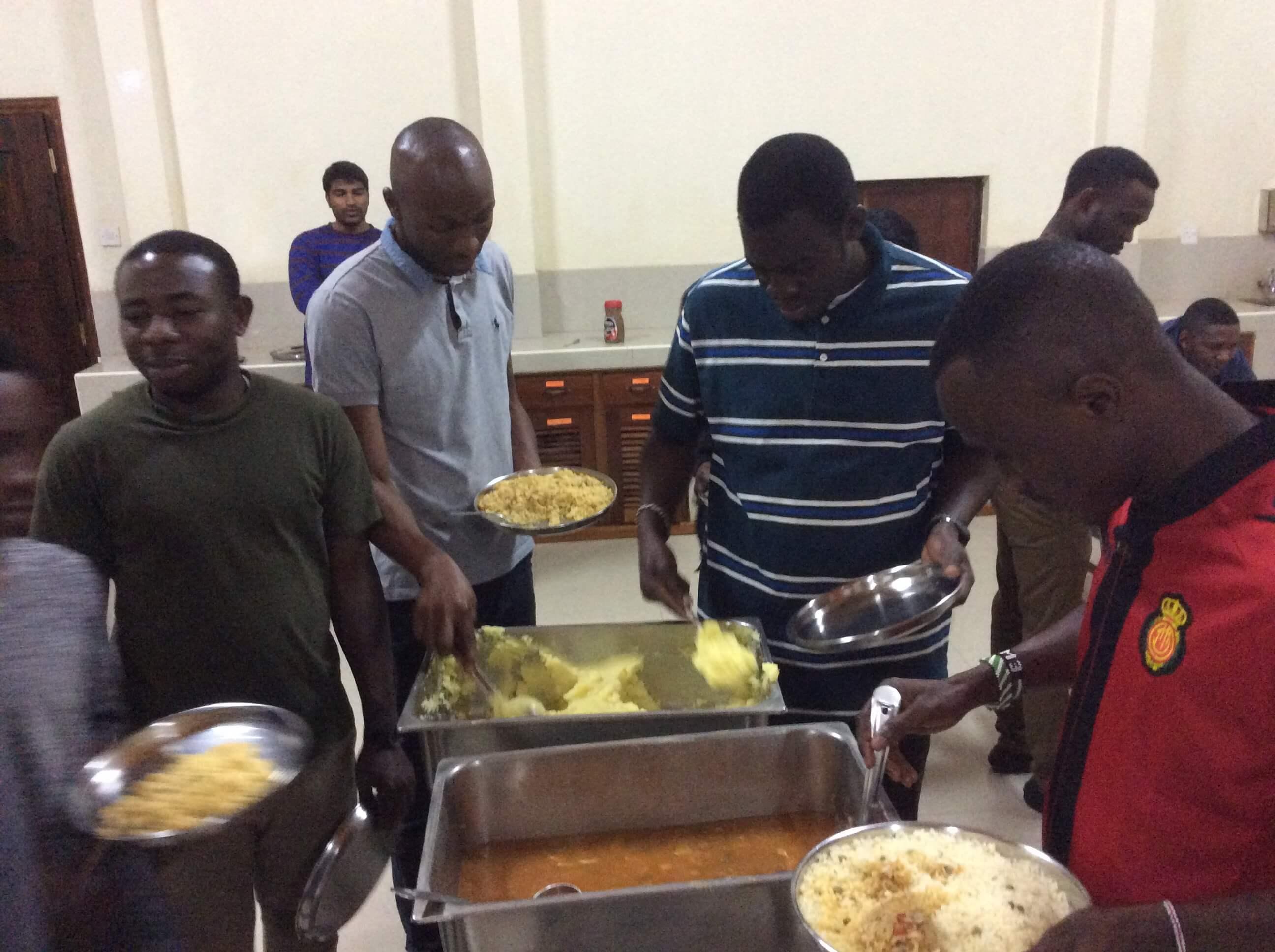 SMA Seminarians at mealtime - food line