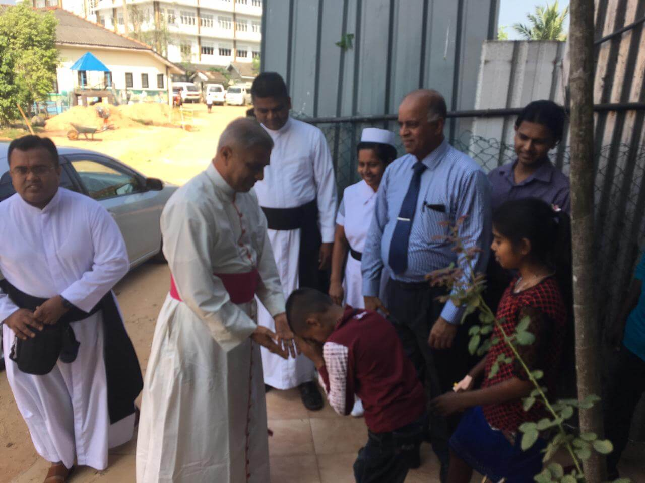 Bishop Perera distributes the presents brought for the children and their families - Sri Lanka