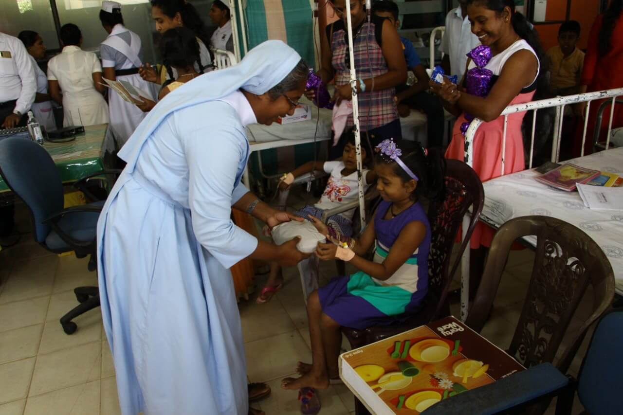 Christmas presents are given to the sick children in Sri Lanka